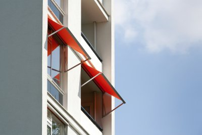 Install awning on apartment building in New York City